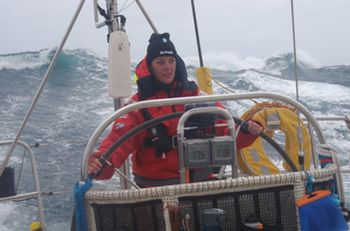 JLB_091127_Lindsey on the helm in the Southern Ocean_PB260644_351